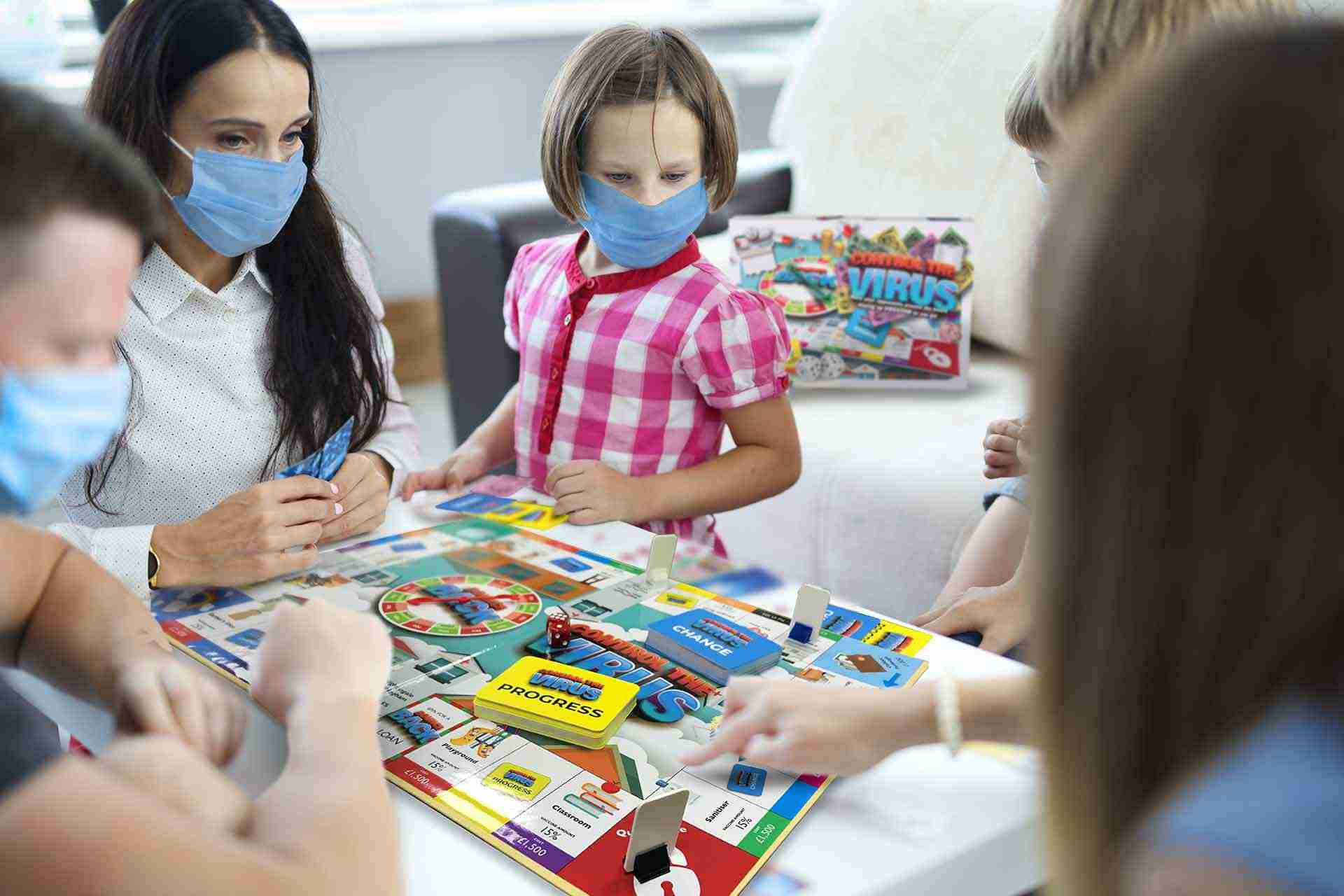 Adults and children in medical protective masks play board games